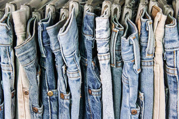 Row of second hand jeans