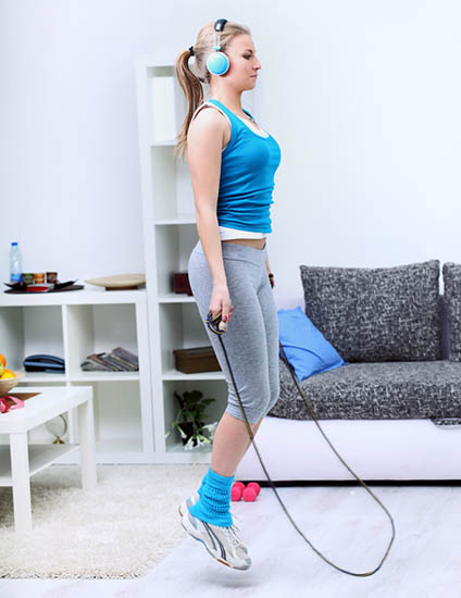 woman jumping rope at home