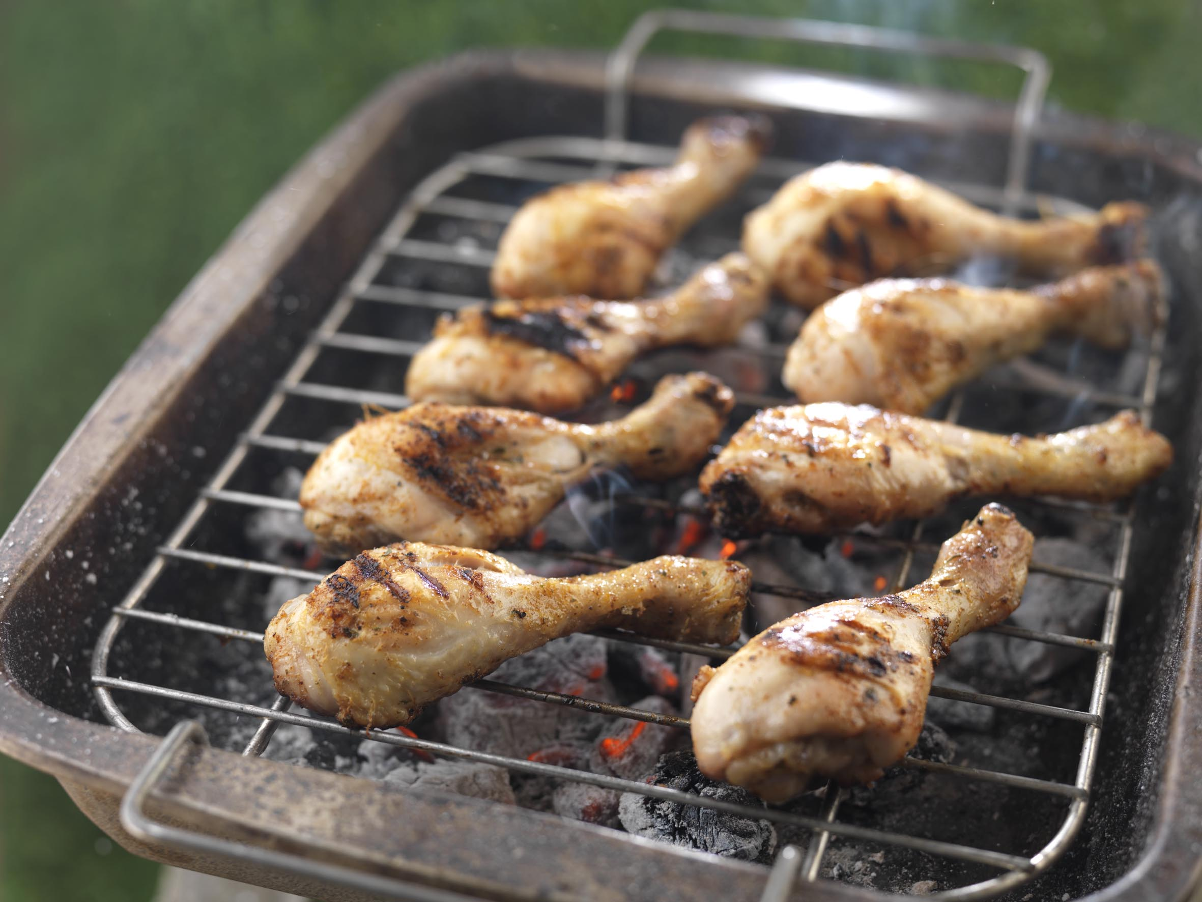 Chicken drum sticks on a BBQ