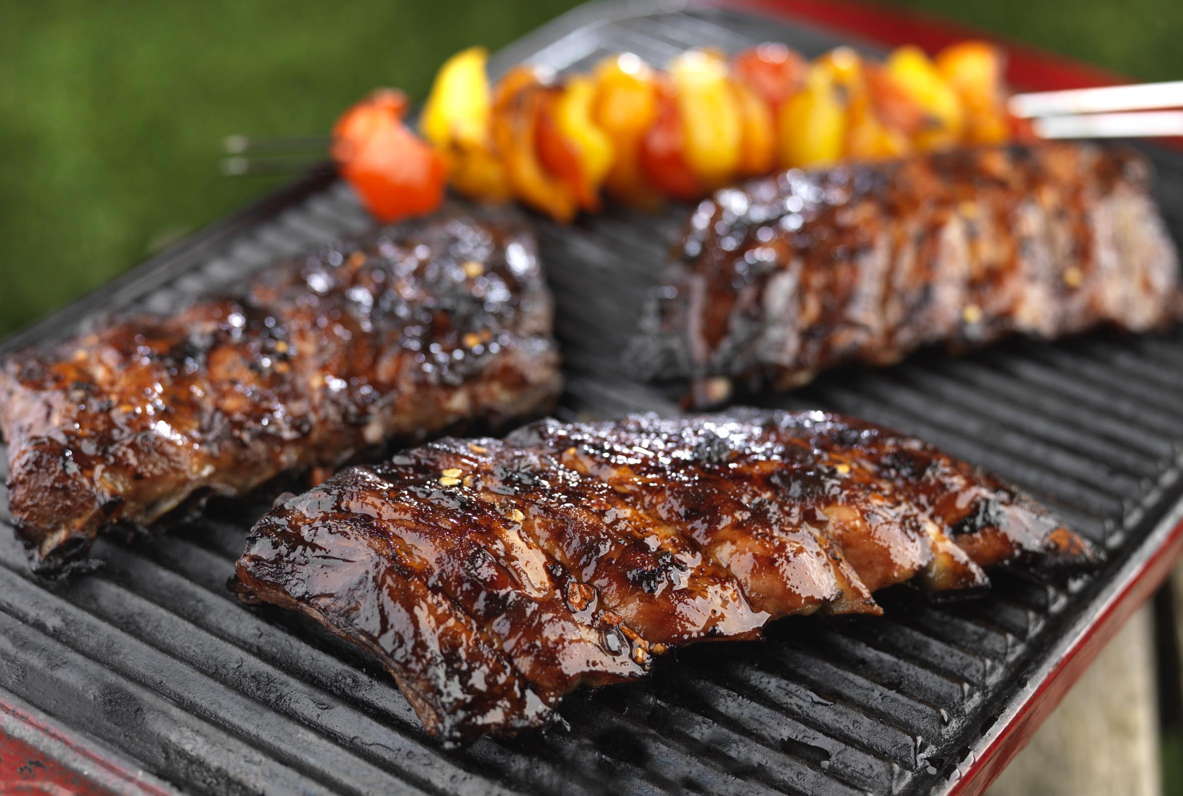 Ribs cooking on a Bank Holiday BBQ - it could be yours